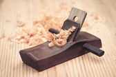 Wood planer and shavings closeup — 图库照片
