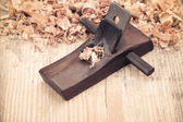 Wood planer on wooden background — Stock Photo