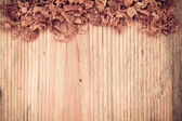 Wooden board with woodchips — Stock Photo
