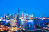 Shanghai skyline and huangpu river in nightfall — Stock Photo