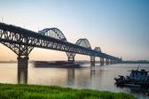 Jiujiang yangtze river bridge at dusk — Stock Photo