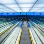 Futuristic downward escalator — Stock Photo #47339227