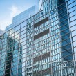 Glass wall in modern building skyscrapers — Stock Photo #47344189