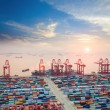 Modern container terminal at dusk — Stock Photo #48932357