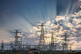 Power transmission tower and sun rays — Stock Photo
