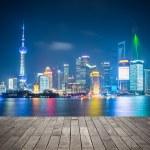 Shanghai skyline at night  with wooden floor — Stock Photo #50557199