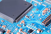 Processor and blue circuit board closeup — Stock Photo