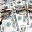 Stock Photo: Heap soft money and old spectacles