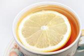 Lemon in the tea — Stock Photo