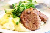 Chop and potatoes — Stock Photo