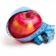 Red apple and metre — Zdjęcie stockowe