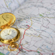 Stock Photo: Old clock and geographical map