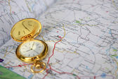 Old clock and geographical map — Stock Photo