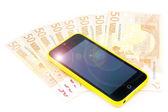 Teléfono y notas del euro — Foto de Stock