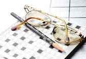 Spectacles, pencil, crossword — Stock Photo