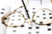 Spectacles, pencil, crossword — Stock fotografie