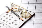 Spectacles, pencil, crossword — ストック写真