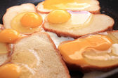 Fried eggs and fried bread — Stock Photo