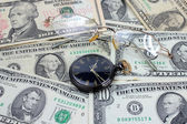 Spectacles dollars watch — Stock Photo