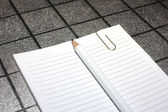 Paper clip, pencil and paper for notes — Zdjęcie stockowe