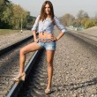 Sexy girl standing on rails — Stock Photo