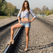 Foto de Stock  : Sexy girl standing on rails