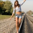 Sexy girl walking on rails — Stock Photo