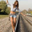 Royalty-Free Stock Photo: Sexy girl walking on rails