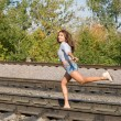 Sexy girl running on rails — Stock Photo