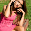 Girl talking by phone — Stock Photo #13664139