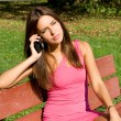 Girl talking by phone — Stock Photo #13664157