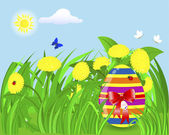 Easter egg in the grass with yellow dandelions. — Cтоковый вектор