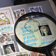 Magnifying glass on a postage stamp — Stock Photo #13195340