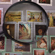 Stock Photo: Magnifying glass on postage stamp