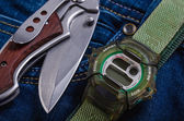Pocket knife and electronic watches — Stock Photo