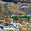 Landscape with train shot on a tilt shift lens - Stock Photo