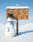 Snowman with billboard — Stock Photo