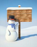 Snowman with billboard — Stock Photo