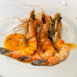 Shrimps on a white plate - Stock Photo