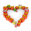 Gifts arranged in shape of heart — Stock Photo