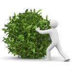 3d man with green grass ball — Stock Photo