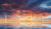 Wind turbines on water. Sunset — Stockfoto