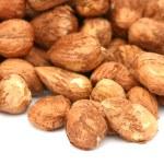 Many hazel nuts on white background — Stock Photo