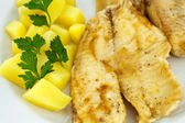 Fried fish with boiled potatoes — Stock Photo