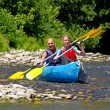 Two in canoe enjoying holidays and nice weather — Stock Photo