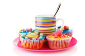 Pink plate with cup of coffee and cupcakes — Stock Photo