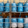 Storage with bottles of gas - Stock Photo