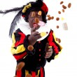 Zwarte piet ( black pete) typical Dutch character — Stock Photo #13397501