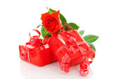 Red presents and rose — Stock Photo