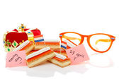 Typical Dutch tompouce sweet with crown and glasses — Stock Photo